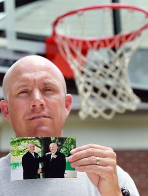 Shannon Minor in June of 2013 with a photo of himself and his father, Pete, taken at his 2003 wedding.