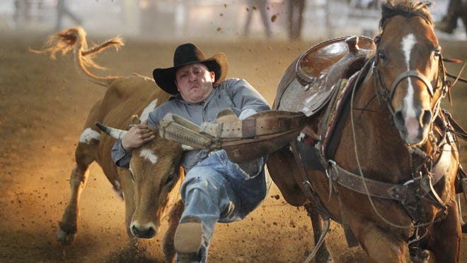 Jake Thomas tries to wrestle down a steer at last year's Kiwanis Rodeo. The 29th Kiwanis Rodeo takes place this Friday and Saturday at the Montgomery County 4-H Arena.