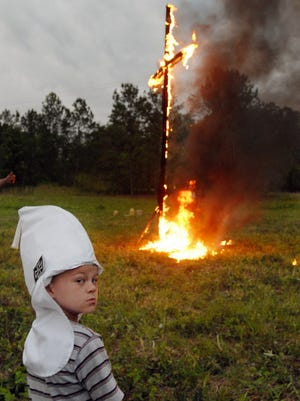 A Ku Klux Klan cross lighting ceremony near Vina, Ala., in 2006.