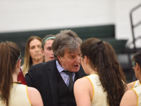Jeff Jasper talks to one of his players during a game. Jasper's intense style on the sideline has been a hallmark of his 45-year coaching career.