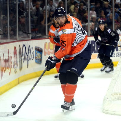 Toledo Walleye defender Richard Nedomlel looks to clear the puck  against the Kalamazoo Wings in 2013 in Toledo.