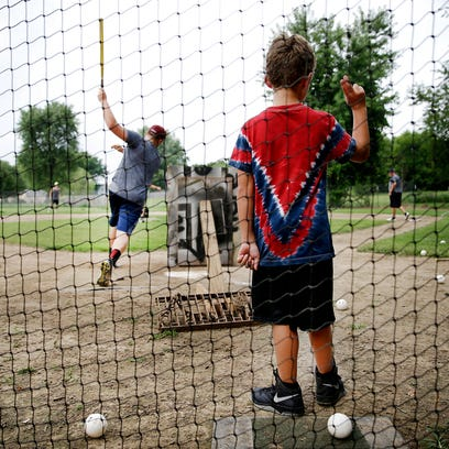 Kevin, 9, calls a strike during a game between the