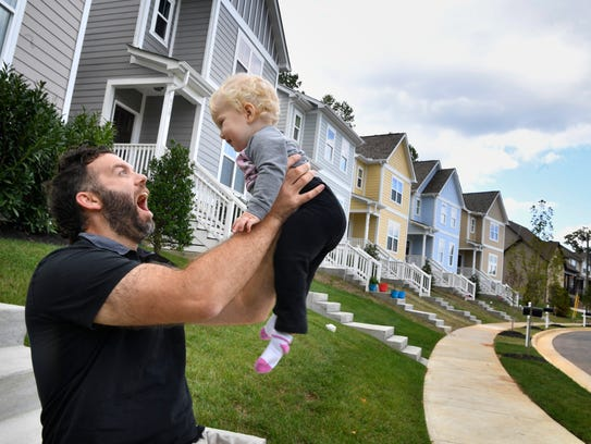 Eric Desch plays with his 1-year-old daughter Bea on