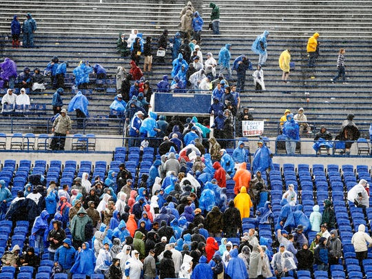 Memphis fans make a mass exodus from the stadium during a rain delay against SMU during fourth quarter action in Memphis, Tenn., Saturday, November 18, 2017.