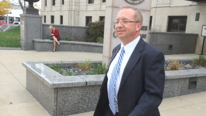 Ron Paul 2012 deputy campaign manager Dimitri Kesari leaves the federal courthouse in Des Moines after his October trial.