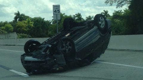 Vehicle rollover on the Midpoint Bridge in Cape Coral in the lanes headed toward Fort Myers on Tuesday afternoon, Sept. 30, 2014.