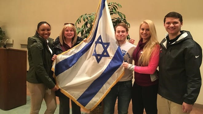 """(From left) Richaunda Gibbs; Terry Kuhnreich, Search for Conscience teacher at Vineland High School; Joshua Davidson; Adrianna Lusinski, vice president of Search for Conscience' and Jeff Martine, senior class president, attended the presentation, """"Shia v. Sunni: ISIS, Syria, and More."""""""