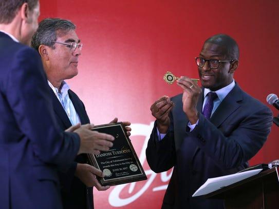 Mayor Andrew Gillum awards Danfoss executives with