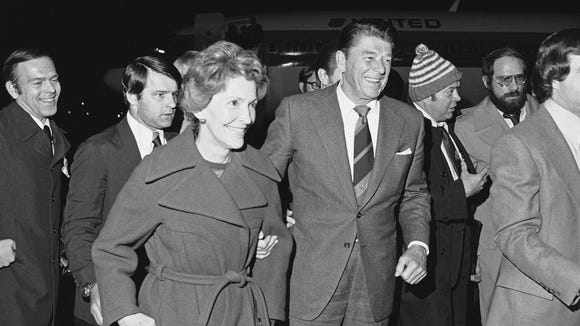 Ronald Reagan, and his wife, Nancy, deplane at Manchester,