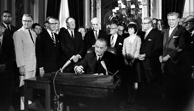 President Johnson signs the Voting Rights Act of 1965 in a ceremony in Washington on Aug. 6, 1965.