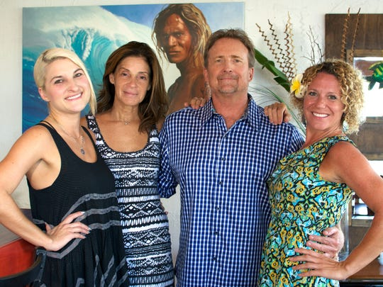 Dewey Siljestrom, second from right, said he tells his whole staff to be on alert at all times, because any diner can write an online review of his Fat Kahuna's Grill and Bar in Cocoa Beach. From left are server Melissa Alderman, owners Kat and Dewey Siljestrom, and server Hilary Golden.