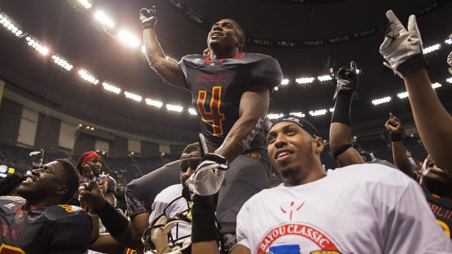 Grambling State wide receiver Martez Carter (4) and teammate celebrate their win over Southern University in the Bayou Classic in the Superdome. The Tigers went 9-0 in the SWAC in 2015.