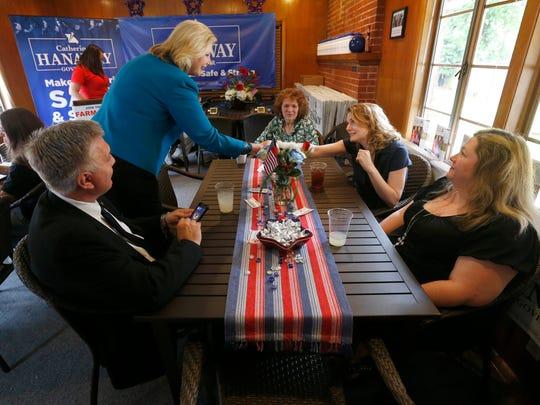 Gubernatorial candidate Catherine Hanaway shakes hands