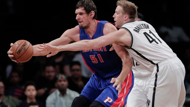 Detroit Pistons center Boban Marjanovic (51) pulls in the ball against Brooklyn Nets center Justin Hamilton (41) during the third quarter. The Nets won 101-94.