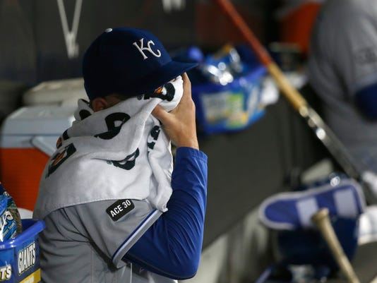 Kansas City Royals starting pitcher Danny Duffy wipes his face in the dugout after being pulled by manager Ned Yost during the fifth inning of a baseball game against the Chicago White Sox, Tuesday, April 25, 2017, in Chicago. (AP Photo/Charles Rex Arbogast)