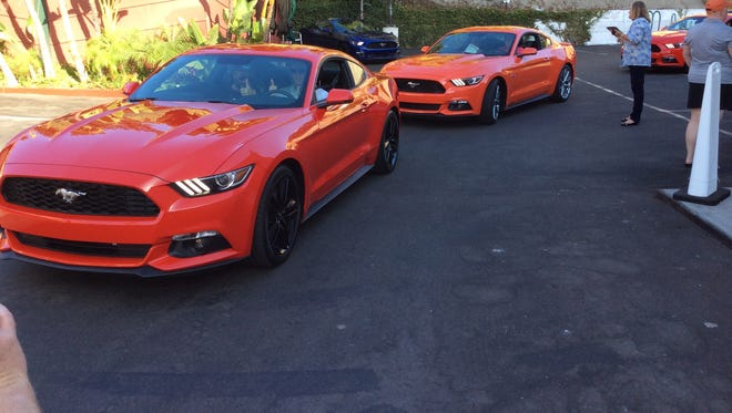 Ford's 2015 Mustang leaving Mel's Drive In in Los Angles on Sept. 18, 2014, piloted by pairs of auto writers getting their first wheel time in the radical makeover of the iconic sporty coupe.