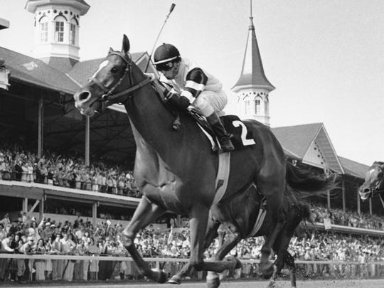In this May 6, 1978, file photo, Affirmed, with jockey Steve Cauthen up, crosses the finish line to win the 104th running of the Kentucky Derby in Louisville, Ky.