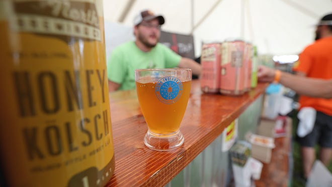 Matt Kryger/IndyStar 2015 file photo A sellout crowd of about 8,000 beer lovers were on hand for the 20th annual Indiana Microbrewers Festival in July 2015. A glass of Citra Fest is freshly poured at 450 North Brewing Company?s booth. This year?s event is slated for July 29 in Military Park. A sellout crowd of about 8,000 beer lovers were on hand for the 20th annual Indiana Microbrewers Festival Saturday, July 18, 2015, afternoon in Military Park. A glass of Citra Fest freshly poured at 450 North Brewing Company's booth.