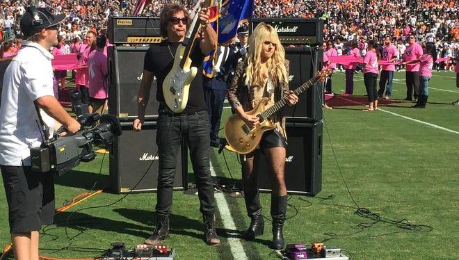 Richie Sambora and Orianthi prior to Sunday, Oct. 11's Oakland Raiders game.