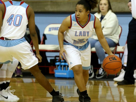 Hirschi's Jania Vinson dribbles around a screen in