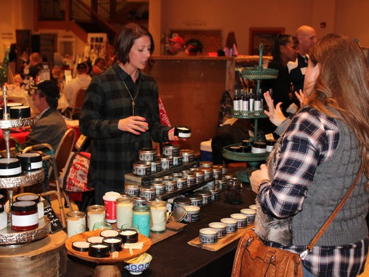 Melissa Miller, left, displays products at her Elizabeth