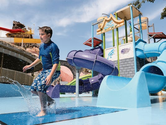 Rafael Garcia, 11, plays in the new Atlantis area of Wet-N-Wild Waterworld on Wednesday. The KLAQ Balloonfest, including the balloon launch, will take over the park this weekend.