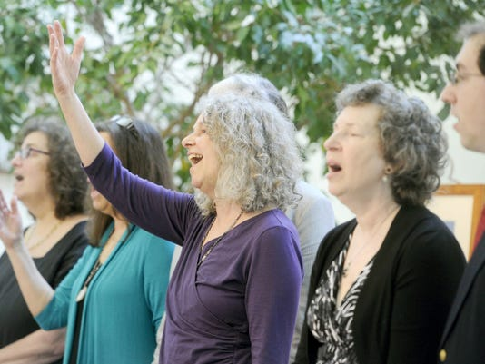 The family of Henry Leader leads a room full of mourners in song during his memorial service at the Unitarian Universalist Congregation of York on Saturday.