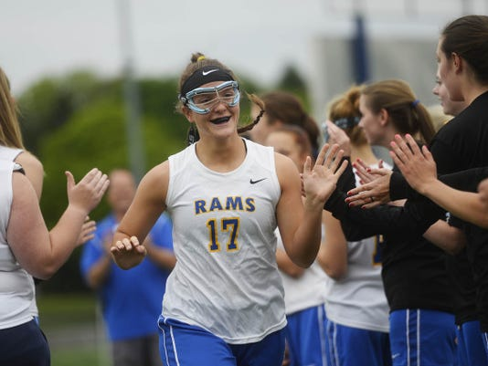 Kennard-Dale's Lyndsey Duty high-fives teammates as she takes the field before the District 3 third place game against Susquehannock at Lower Dauphin Middle School in Hummelstown on May 21. Duty tore her ACL during the lacrosse season last year, and came back towards the end of this year's basketball season. For a comprehensive report on ACL injuries, who they affect most and what's being done to prevent more in the future, log on to www.GameTimePA.com.
