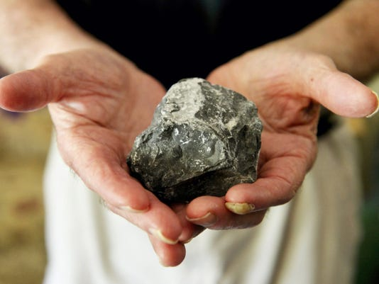 """Roger Luckenbaugh holds a rock that he said broke a window belonging to Edna Haker, a 95-year-old woman who owns a home on the 800 block of Edgar Street. Luckenbaugh, 78, said the unruly teenagers are different ages, genders and races. """"The kids get away with it,"""" Luckenbaugh said. """"They don't have to pay for nothing."""""""