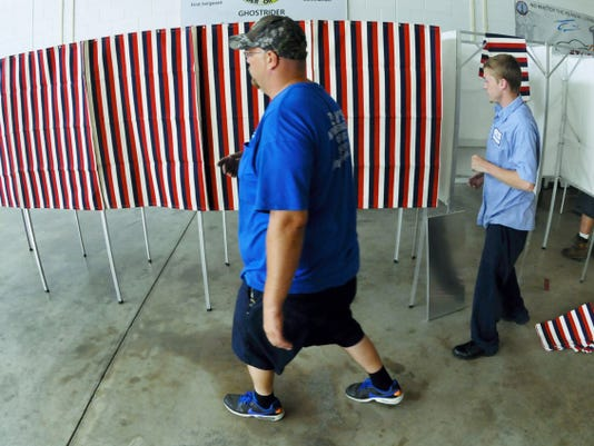 Ronald Wilson, left, and Sean Hurley of,  Zody's Moving and Storage, setup voting booths Monday, May 18, 2015 at the National Guard Armory, Chambersburg. Markell DeLoatch - Public Opinion