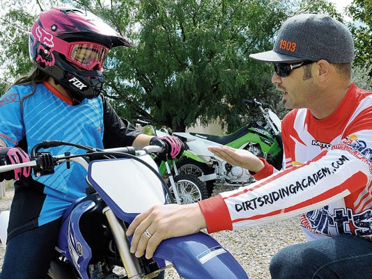 Robin Zielinski   Sun-NewsRobert Walraven, Dirt´s Riding Academy owner, explains gear shifting with a student on Monday.