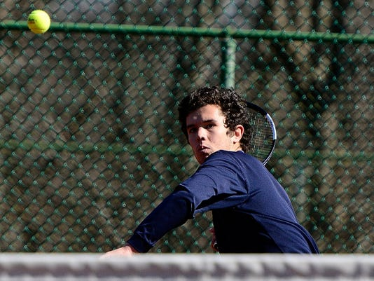 Dallastown's John Schmitt, above, won a three-set match over Red Lion's Sam Innerst at No. 1 singles on Thursday afternoon.