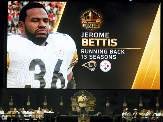 Former NFL running Jerome Bettis delivers his speech with a videoboard in the background honoring his 13 years of NFL service during the Pro Football Hall of Fame induction ceremony on Saturday in Canton, Ohio.