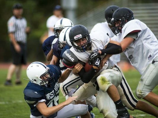 The West York football team (blue jerseys) scrimmaged South Western on Aug. 27 at South Western High School in Hanover. The Bulldogs open their season tonight, with a 7 p.m. home game against Central York.