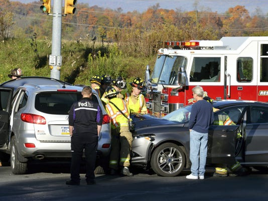 Fire and rescue personnel from Ebenezer, Glenn Lebanon Speedwell fire companies and First Aid and Safety Patrol work at a motor vechicle accident at Route 72 and Long Lane Saturday morning.