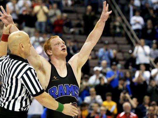 Kennard-Dale's Chance Marsteller greets the crowd's