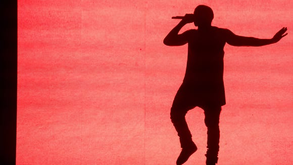Kanye West performs at the Budweiser Made in America Festival on Saturday in Philadelphia.