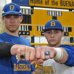 Buena Regional High School baseball players Denny Brady (left) and Marco Rios show off their 2014 state championship rings at a recent practice.