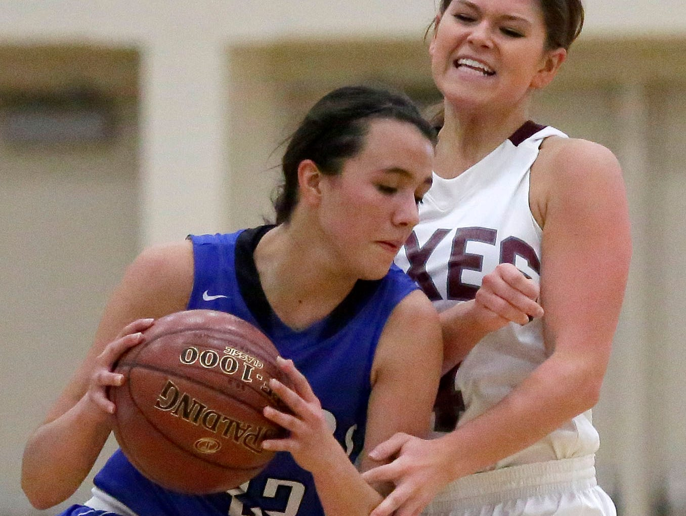 Whitney Henn of Fox Valley Lutheran defends against Kailee Van Zeeland of Wrightstown in a North Eastern Conference girls basketball game on Tuesday.