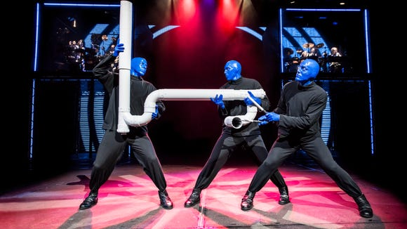 The Blue Man Group performs a piece of music on PVC pipe. The group is performing at The Luxor in Las Vegas.