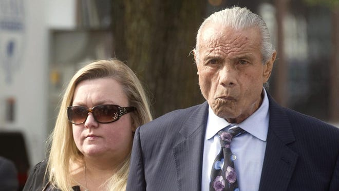 Former professional wrestler Jimmy 'Superfly' Snuka, right, arrives for his formal arraignment at the Lehigh County Courthouse in Allentown, Pa. Snuka, who now lives in Waterford Township, has pleaded not guilty to third-degree murder charges in the death of his mistress more than three decades ago.