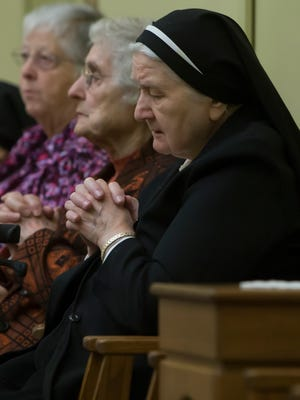 The Catholic community gathers for Mass of Thanksgiving in honor and in memory of the Sisters who arrived at Sisters of the Sorrowful Mother Franciscan Courts led by Bishop Robert Morneau October 14, 2014.