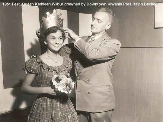 1951 Fall Festival queen Kathleen Wilbur is crowned by Downtown Kiwanis President Ralph Becker. In the festival's early days, queens were chosen by votes cast at businesses along Franklin Street.