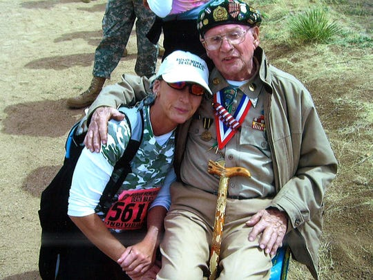 In this photo, taken in 2010, Starr poses for a photo with one of the veterans who attended the march. After her first time participating in 2000, Starr was so overwhelmed by the experience and other participants that she continued to take part in the 26.2 mile walk each year.