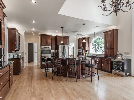 The kitchen has ample cabinets and granite countertops.