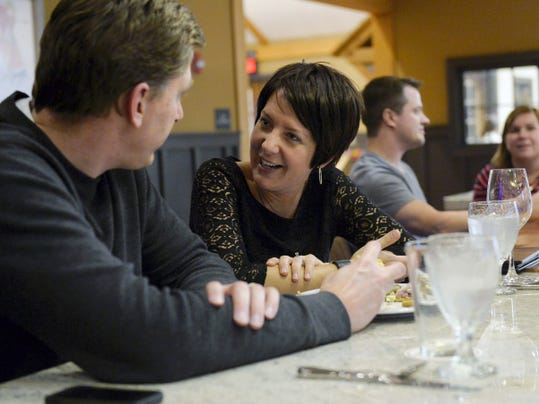 Jeremy and Heather Flagel of York Township share a pizza together in the tasting room at Wyndridge Farm in York Township last month. The tasting room, which features seasonal dishes, has seen two-hour wait times on Fridays and Saturdays.