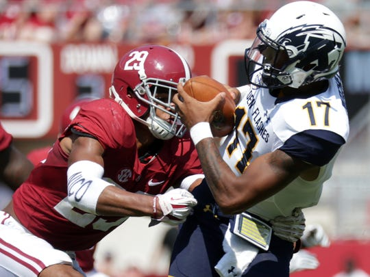 Sep 24, 2016; Tuscaloosa, AL, USA;  Kent State Golden Flashes quarterback Mylik Mitchell (17) attempts to get away from Alabama Crimson Tide defensive back Minkah Fitzpatrick (29) at Bryant-Denny Stadium. Mandatory Credit: Marvin Gentry-USA TODAY Sports