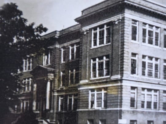 A copy of an old photo of the Shreveport High School.