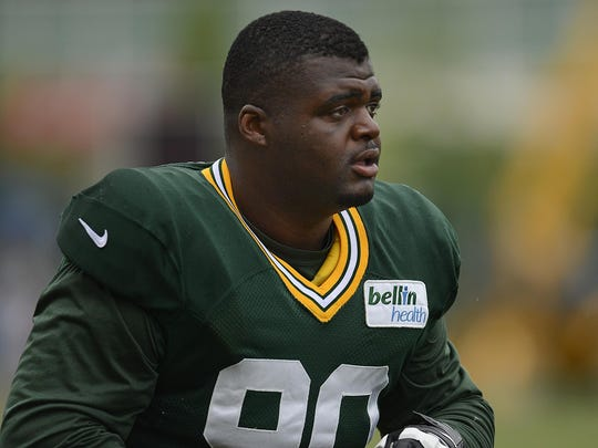Green Bay Packers nose tackle B.J. Raji runs onto the field during training camp practice in August 2015 at Ray Nitschke Field.