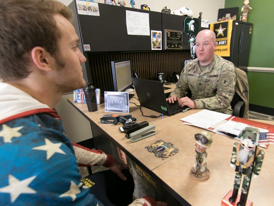 Sgt. Graham Kimmel, right, talks on Wednesday, April